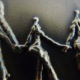 Detalle medalla en bronce de Familia